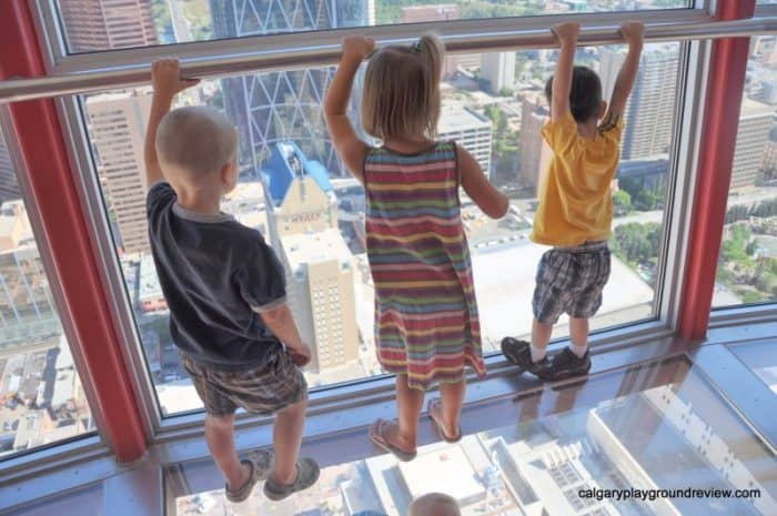 View from the Calgary tower and three kids