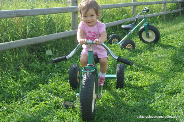 Girls on a green trike