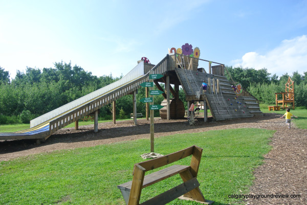 Large wooden play structure with slides