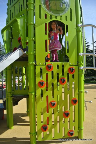 GIrl on green climber