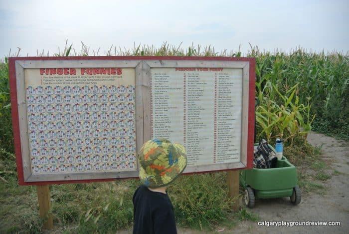 Board outside the small corn maze at the Calgary Farmyard