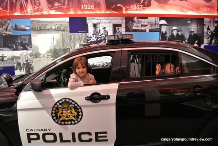Kids in a police car photo op - Calgary Youthlink Police Interpretive Centre