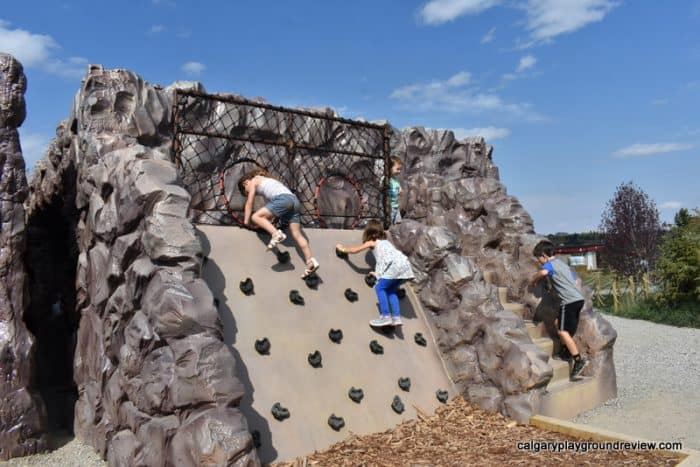 Small climber wall with kids climbing