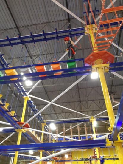 Child climbing around the Indoor Aerial Rope Course - at the Big Box