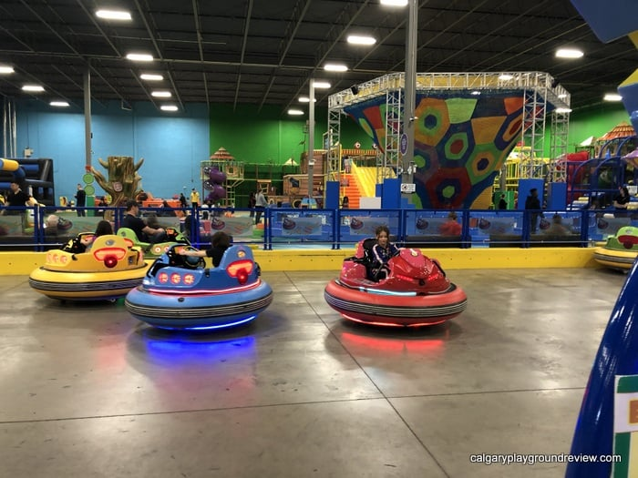 Kids in the Happy Bumper Cars at the Big Box with the Leisure Lagoon in the background