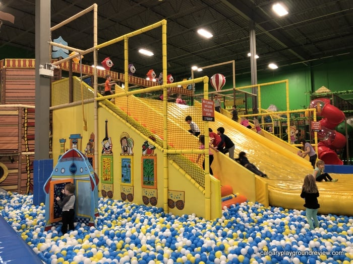 Kids climbing up the wide slide at the Big Box