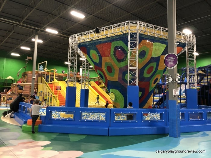 Net climber with wide slide and ball pit